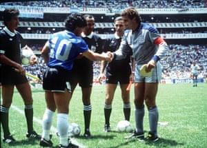 Peter Shilton shakes Diego Maradona's right hand as the captains swap pennants