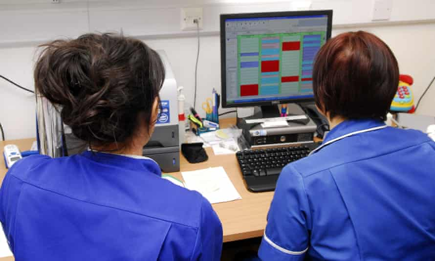 Nurses looking at a computer