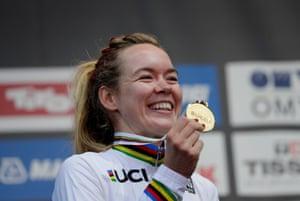 Anna van der Breggen of the Netherlands celebrates with her medal on the podium.