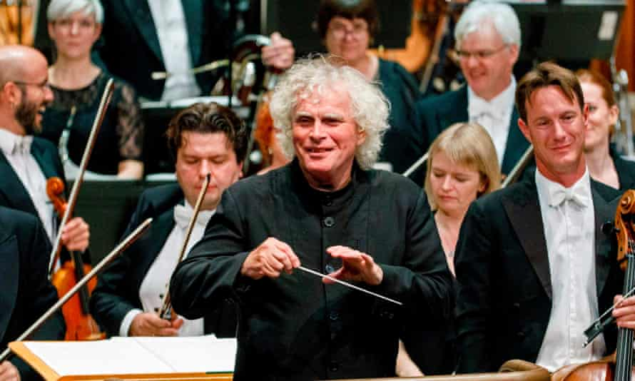 Sir Simon Rattle conducting the London Symphony Orchestra at the Barbican in London.