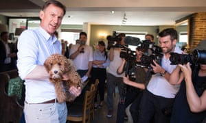 Jeremy Hunt with Frankie, a Cava-Poo at The Keep pub in Guildford, Surrey.