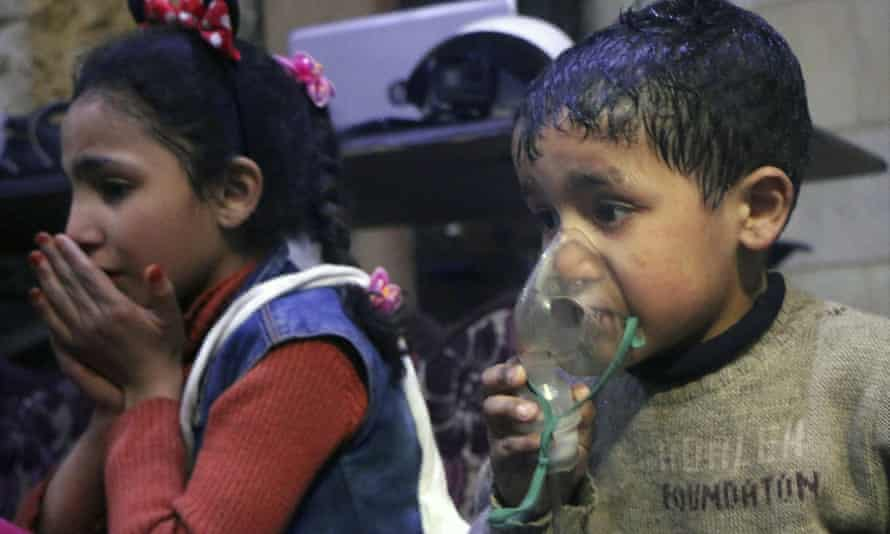 An image released by the Syrian White Helmets, shows a child receiving oxygen following a suspected sarin attack in Douma.