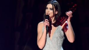 Dua Lipa accepts the award for British solo female artist – the only woman to win in a category where she was pitted against all-male nominees.
