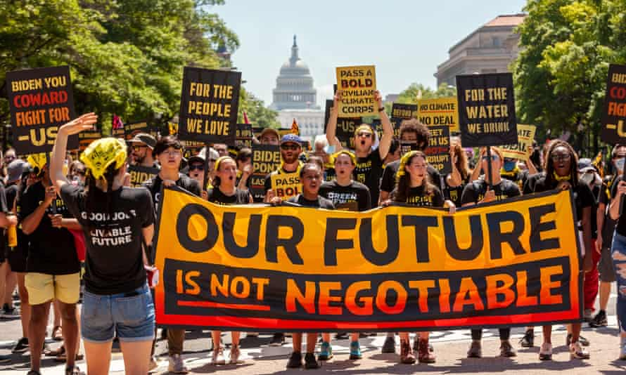 Hundreds of protesters march to the White House calling for climate action, including a Civilian Climate Corps.