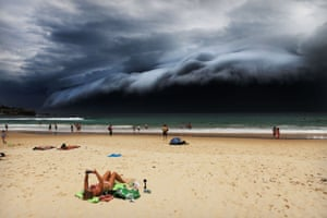 Nature, first prize, singles - Rohan Kelly - Sunbather oblivious to the ominous shelf cloud approaching on Bondi beach, Australia