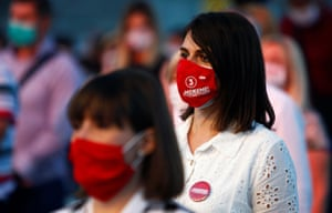 """Skopje, North Macedonia A woman wearing a mask with the slogan """"We can!"""" attends a gathering with Zoran Zaev, leader of the ruling SDSM party, and supporters after planned snap elections had to be postponed due to coronavirus"""