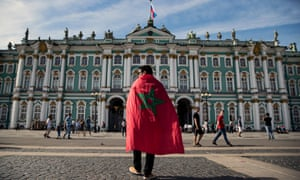 A Morocco supporter in front of the State Hermitage museum in St Petersburg