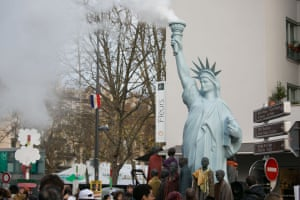 A sculpture by Danish art activist Jens Galshiøt, Freedom to Pollute, at the People's Climate Summit in Montreuil, in the east of Paris