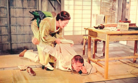 Machiko Kyo and Glenn Ford in The Teahouse of the August Moon, 1956.