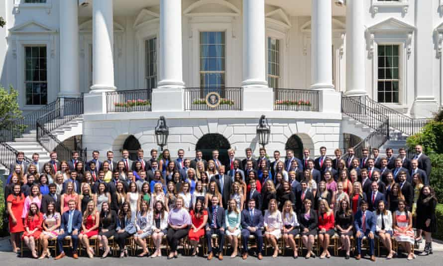 The 2018 Summer White House Intern Class pose with Donald Trump on the South Lawn