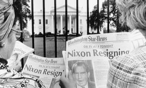 Newspaper headlines about President Nixon's resignation being read by tourists in front of the White House.