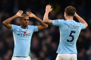 Fernandinho and Stones celebrate victory.