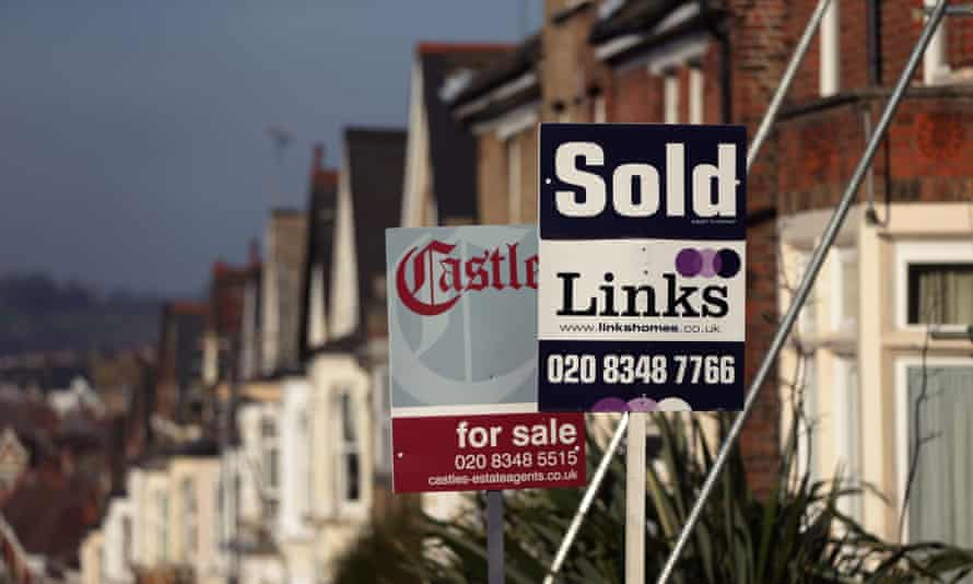 Estate agent signs outside houses in north London