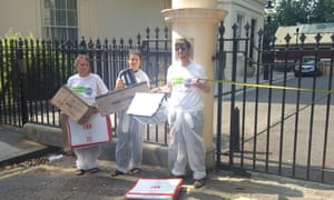 Anti-Brexit campaigners dressed up in removal overalls protest outside Carlton Gardens