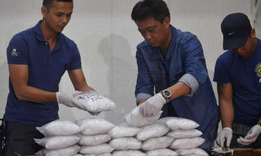 Philippine national police stack plastic bags of crystal meth
