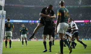 New Zealand players celebrate Barrett's try