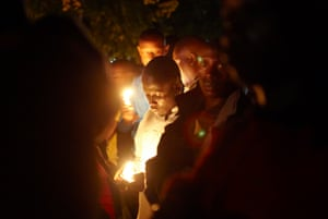 Relatives and survivors gather for a candlelit vigil in April 2013 at the site where, during the genocide of 1994, more than 11,000 Tutsi men, women and children were slaughtered by Hutu extremists as they sought refuge in the grounds of Kibuye Roman Catholic church, Rwanda