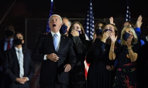 Joe Biden and his family react to fireworks during a celebratory event held outside of the Chase Center in Wilmington, Delaware.