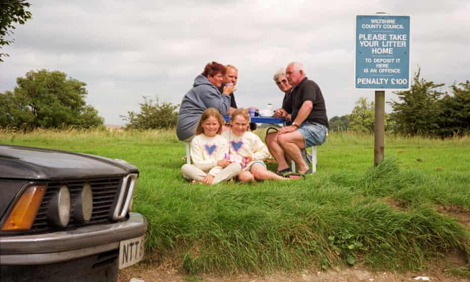 Peter Dench's photograph of a family at 'the world's most sociable' lay-by in 2012.