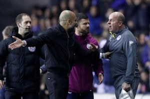 Pep Guardiola clashes with Paul Cook.