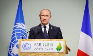 Russian President Vladimir Putin addresses the opening plenary session of the UN climate talks in Paris.