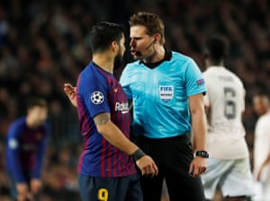 Suarez receives a telling off from referee Felix Brych.