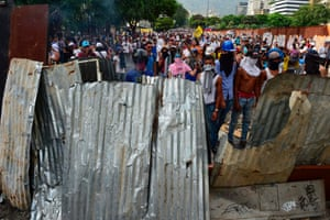 Demonstrators erect barricades against the riot police