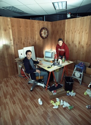 Google co-founders Larry Page (wearing red Stanford sweatshirt) and Sergey Brin posing in a messy office setting on October, 2002 in Mountain View, California.
