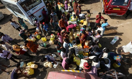 People from the drought-affected districts of Maharashtra collect water from a tank in Mumbai.