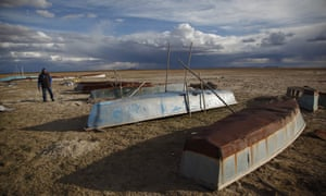 A fisherman walks among boats abandoned along the shore of the dried up Lake Poopó in this photo dated 11 January.