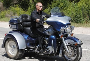 July 2010: Riding a Harley Davidson Lehman Trike as he leaves the meeting with bikers at their camp at Gasfort Lake near Sevastopol in Ukraine's Crimea Peninsula