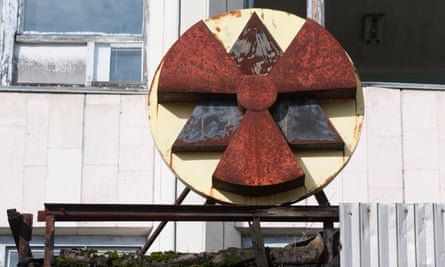 A rusting nuclear sign on a building in Pripyat, which was evacuated within days of the Chernobyl disaster.