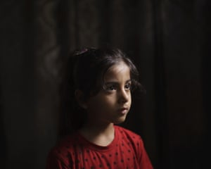 Elien al-Madhoun, six, at her grandfather's house, where she is living after her house was destroyed during an 11-day war, in Beit Lahia, northern Gaza Strip. Elien was not yet born when her father lost his home in the 2014 Gaza War. In May, she screamed out at the sounds of airstrikes and shelling in Bait Lahia in northern Gaza, says her father, Ahmed Rabah al-Madhoun. 'When nine homes are completely destroyed next to one another and my daughter sees this, she can't understand what happened,' he says