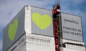 Banners at the top of Grenfell Tower in west London