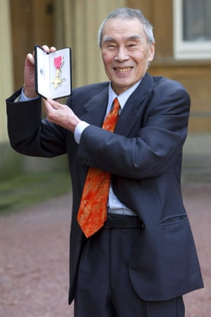 Outside Buckingham Palace after receiving an OBE for services to drama, 2011