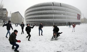 Snow in Bilbao … students throw snowballs in front of the San Mames stadium after a snowfall in Spain.