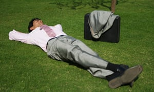 Businessman resting in a park