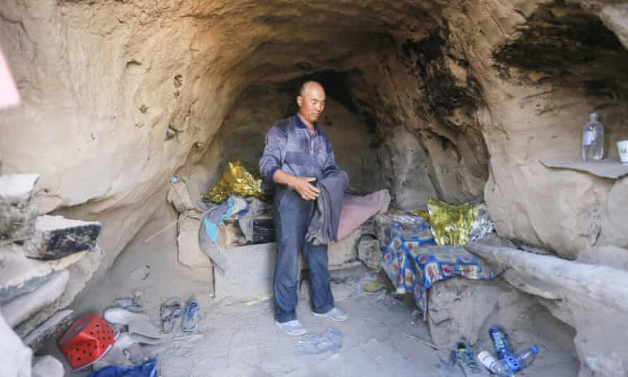 Zhu Keming in the cave where he sheltered the runners. which he had previously stocked up with food and clothes for emergencies.