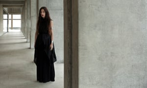 zola jesus standing in a space with concrete pillars