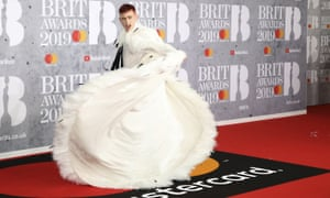 Olly Alexander arrives on the red carpet.