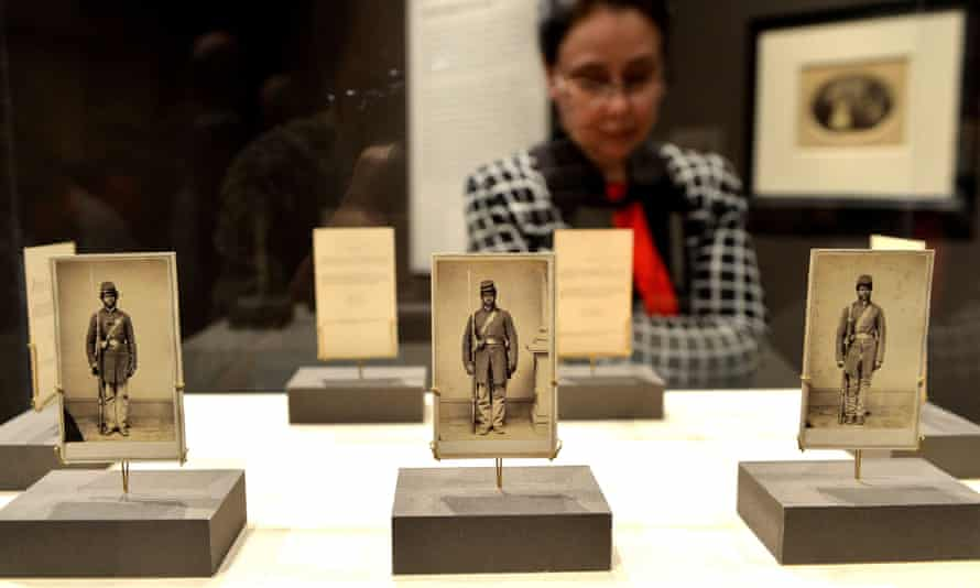 Three photographs of American Civil War soldiers at the Metropolitan Museum of Art in New York.
