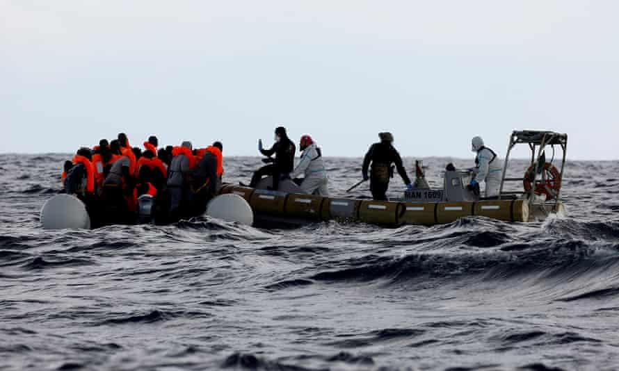 Italian navy personnel on a rescue mission.