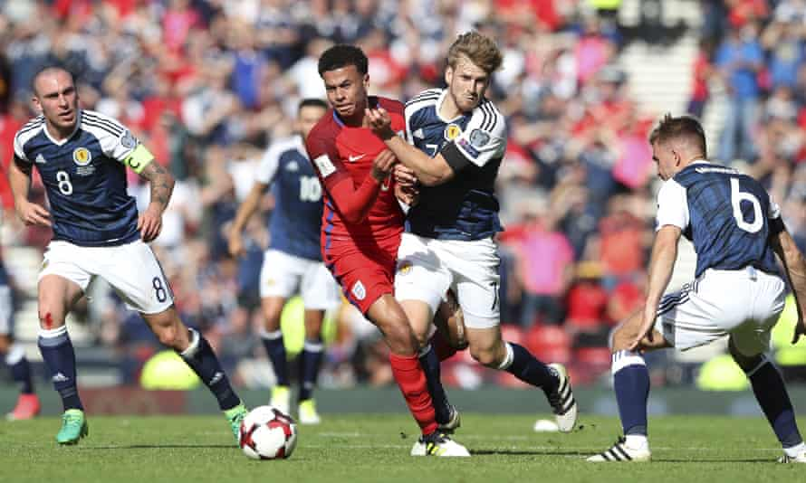 Stuart Armstrong tussles with Dele Alli during Scotland's draw at home to England in June 2017.