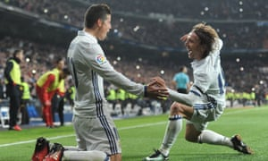 James Rodríguez celebrates with Luka Modric after scoring Real Madrid's third goal against Sevilla before half-time in the first leg of the Copa del Rey tie.
