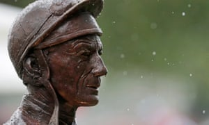 The rain-splattered statue of Lester Piggott at Royal Ascot.
