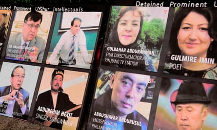 Photographs of prominent Uighur intellectuals detained by China as protesters gather across from the Chinese Consulate in Los Angeles during a global day of action called by 'Resist China'