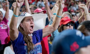 Trump supporters cheer as they await the president's arrival in Phoenix, Arizona.