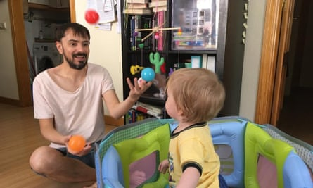 Martin Wilson juggling for his baby daughter.