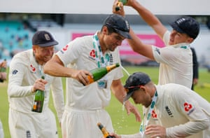 At the post match celebrations Alastair Cook is doused with champagne by Sam Curran.