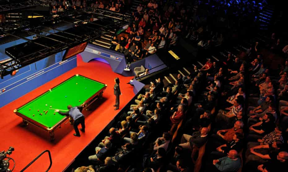 Fans watch a match between Stephen Maguire and Joe Perry at Sheffield's Crucible Theatre in 2012